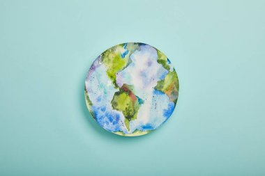 Top view of planet picture on turquoise background, earth day concept stock vector