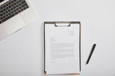 Top view of documet on clipboard, pen, laptop on table stock vector