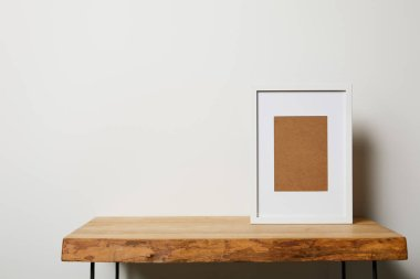 Blank frame on wooden table on white background stock vector
