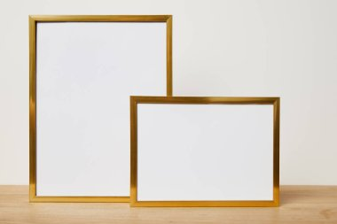 Blank frames on wooden table at home stock vector