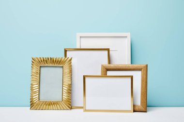 Golden decorative square frames near blue wall stock vector