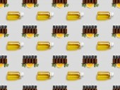 Photo Pattern with essential oil in bottles and sliced orange on grey background