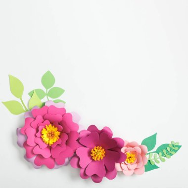 Top view of multicolored paper flowers and leaves on grey background stock vector