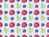 green plants with pink and blue paper flowers on grey, seamless background pattern
