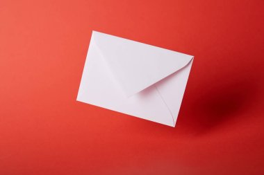White and empty envelope on red bright background with copy space stock vector
