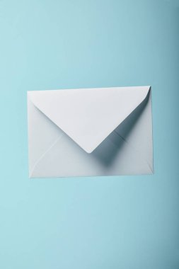 White and empty envelope on blue background with copy space stock vector