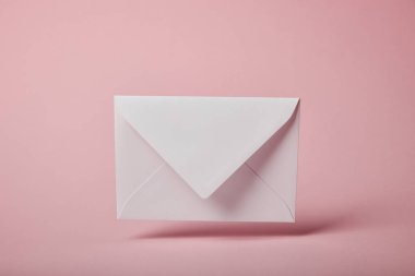 White and empty envelope on pink background with copy space stock vector