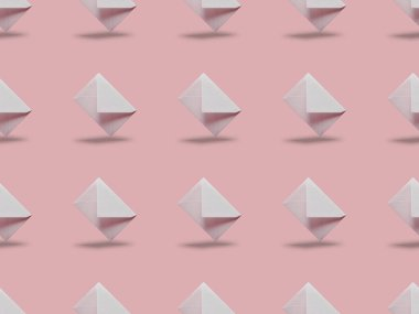 flat lay with white and empty envelopes on pink background with copy space
