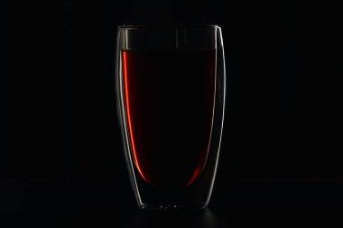 Glass full of burgundy red wine on black stock vector