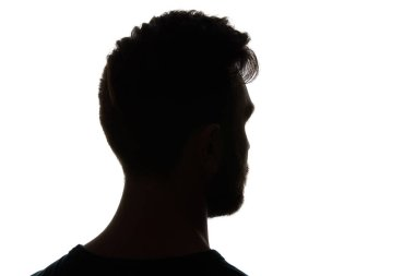 Silhouette of man looking away isolated on white stock vector