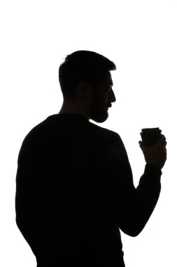 Silhouette of man holding paper cup of coffee isolated on white stock vector