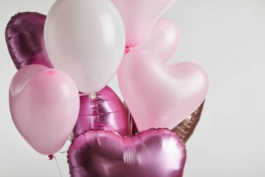 Bundle of heart-shaped pink festive balloons isolated on white stock vector