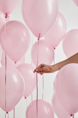 Cropped view of girl with pink air balloons isolated on white stock vector