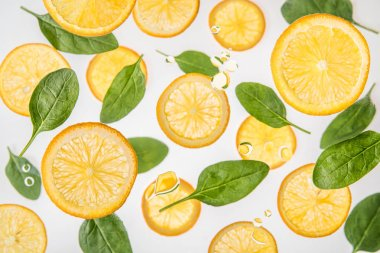 Fresh juicy orange slices with green spinach leaves on grey background with water bubbles stock vector