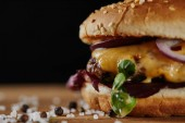 close up of salt and delicious burger with meat, cheese and onions