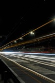 long exposure of bright lights on road at night busy city
