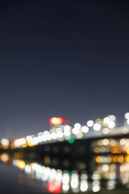 Blurred bokeh lights of illuminated buildings at night stock vector