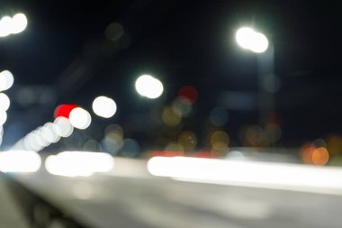Long exposure of bright lights on road at nighttime stock vector