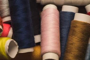 top view of scattered colorful cotton thread coils