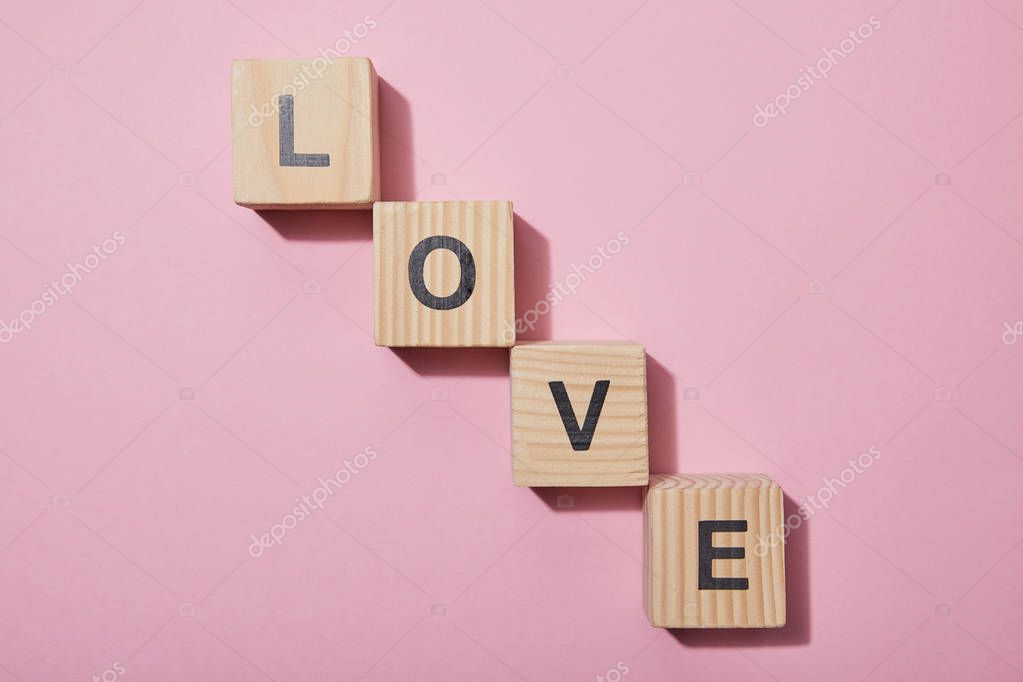 Top view of wooden cubes with letters on pink surface stock vector