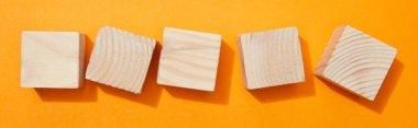 Panoramic shot of wooden blocks on orange surface stock vector