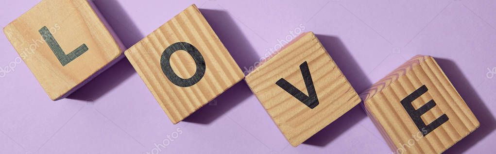 Panoramic shot of wooden blocks with letters on purple surface stock vector