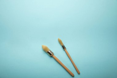 Top view of two brushes on blue surface stock vector
