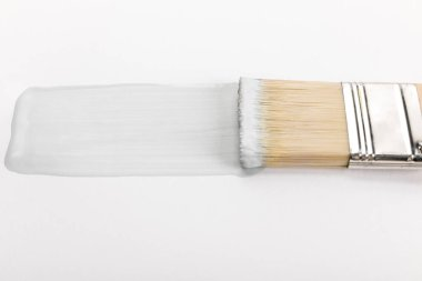 Close up view of brush and brushstroke isolated on white stock vector