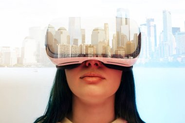 Double exposure of brunette girl wearing virtual reality headset and modern city with skyscrapers stock vector