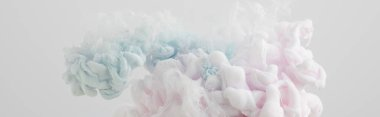 Close up view of light pink and light blue paint mixing isolated on grey