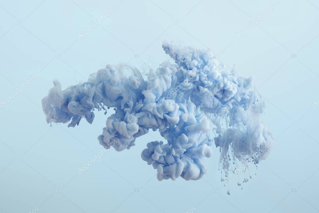 Close up view of blue paint splash isolated on light blue