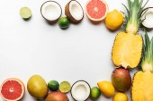 top view of organic exotic fruits on white background with copy space
