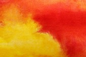close up view of yellow and red watercolor mixed paints
