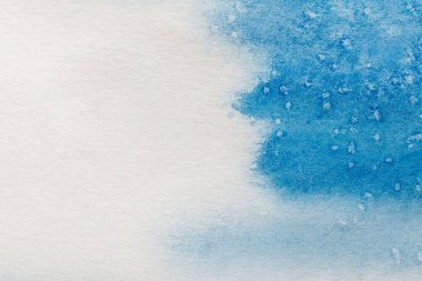 Blue watercolor paint on white textured background with copy space stock vector
