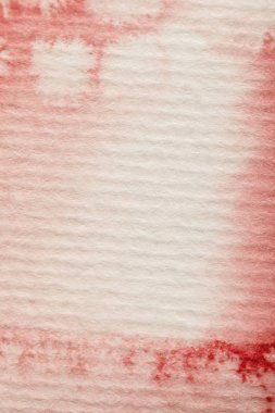 Close up view of red bright watercolor paint spill on textured paper background stock vector