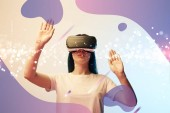 Fotografie young woman in virtual reality headset pointing with hands at glowing and purple abstract illustration on beige and blue background