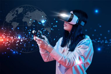KYIV, UKRAINE - APRIL 5, 2019: Young woman in virtual reality headset using joystick on dark background with globe illustration stock vector