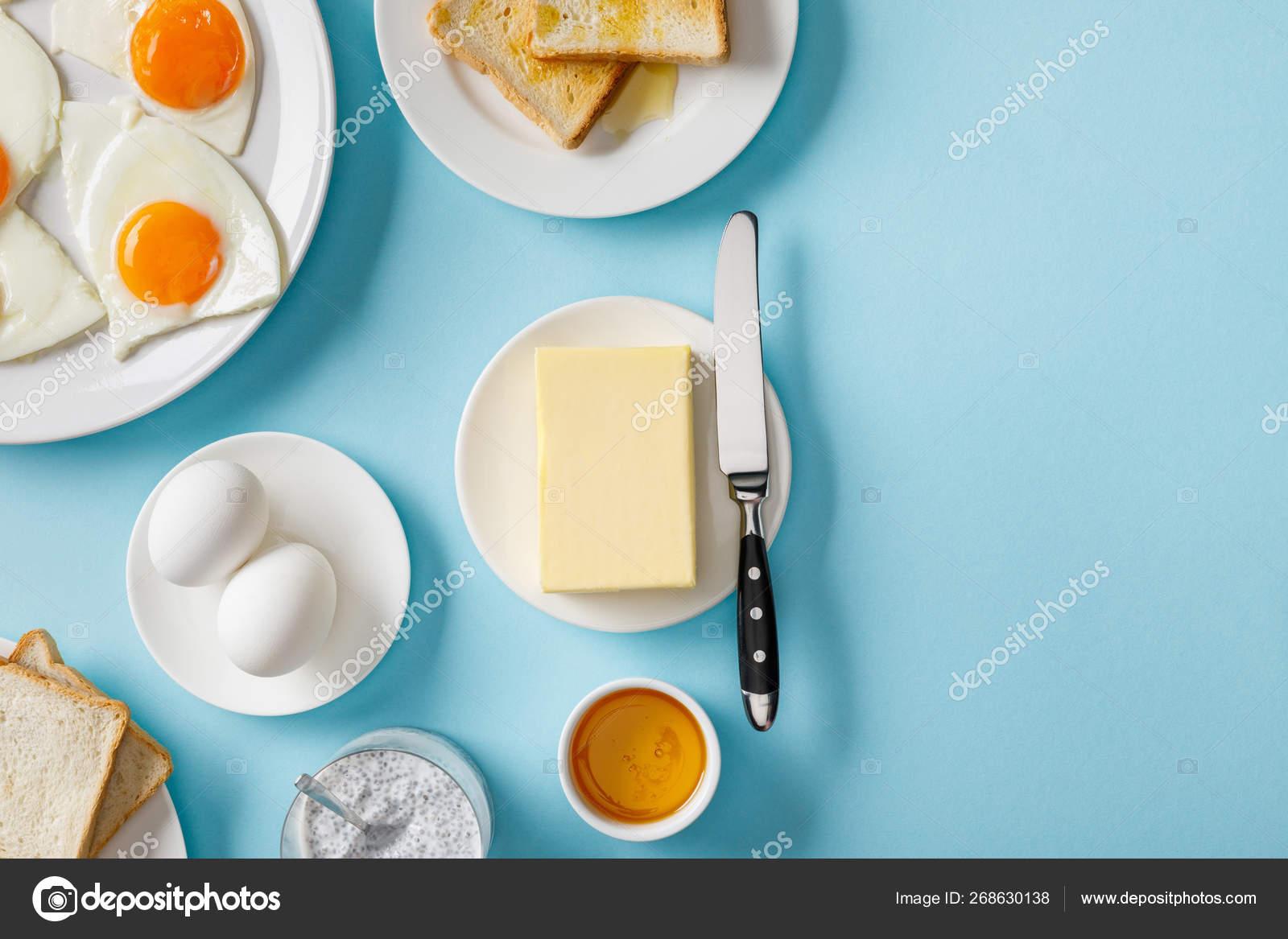 Top View Butter Toasts Fresh Fried Eggs White Plates Yogurt Stock Photo C Antonmatyukha 268630138