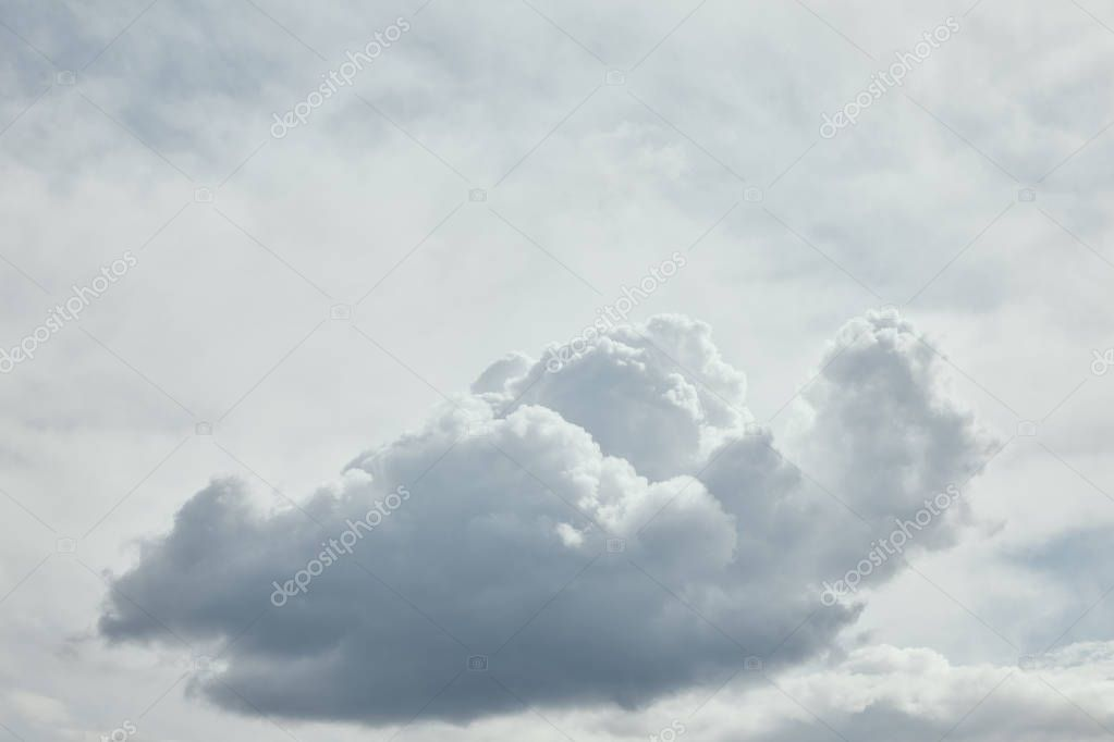 Bright day with dark clouds on sky and copy space