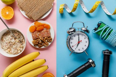 top view of fresh fruits, crispbread and breakfast cereal on pink and dumbbells, alarm clock, skipping rope and measuring tape on blue background