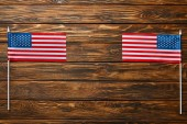Photo top view of national american flags on wooden surface with copy space