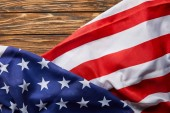 Photo top view of usa flag on wooden surface with copy space