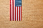 top view of american flag on wooden beige background