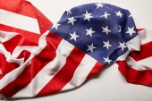 top view of crumpled national american flag on white background