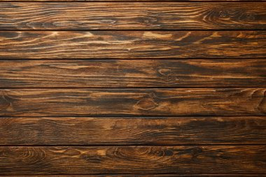 top view of empty brown wooden surface with copy space
