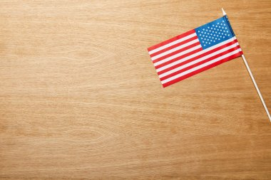 Top view of american flag on wooden light table with copy space stock vector