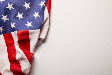 top view of american flag on white background with copy space