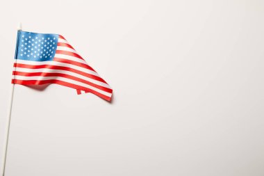 top view of national american flag on white background with copy space