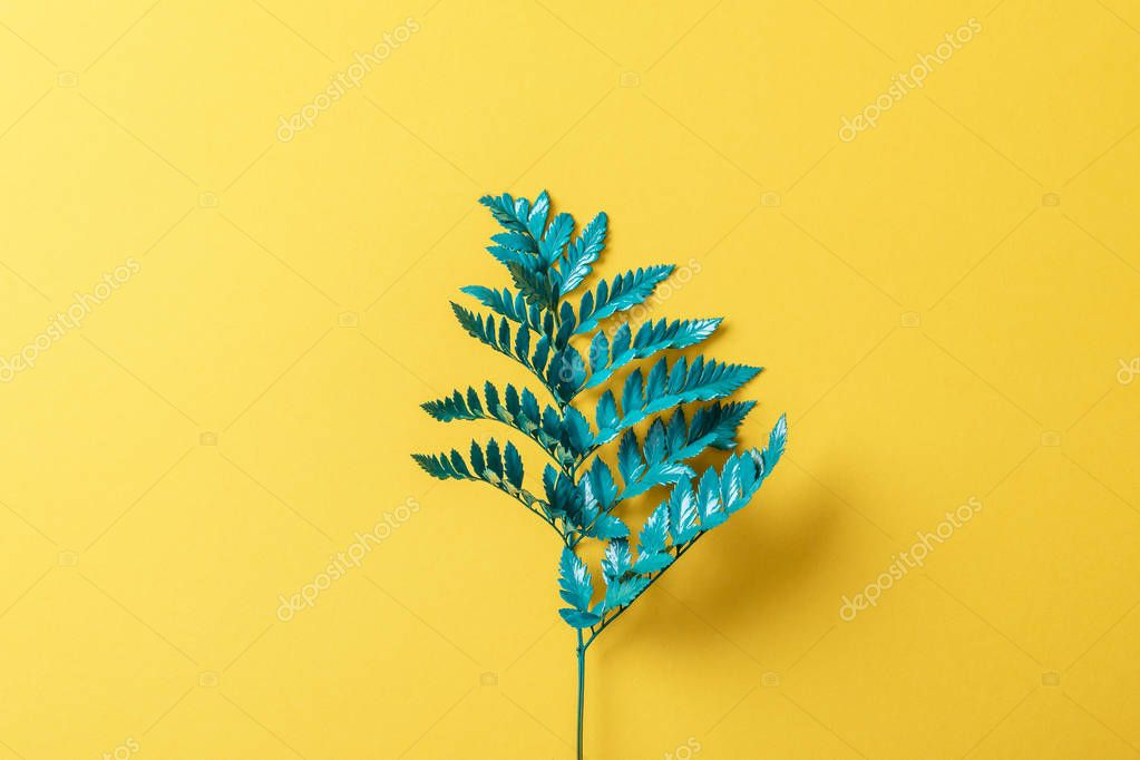 Green fern leaf on yellow paper background stock vector