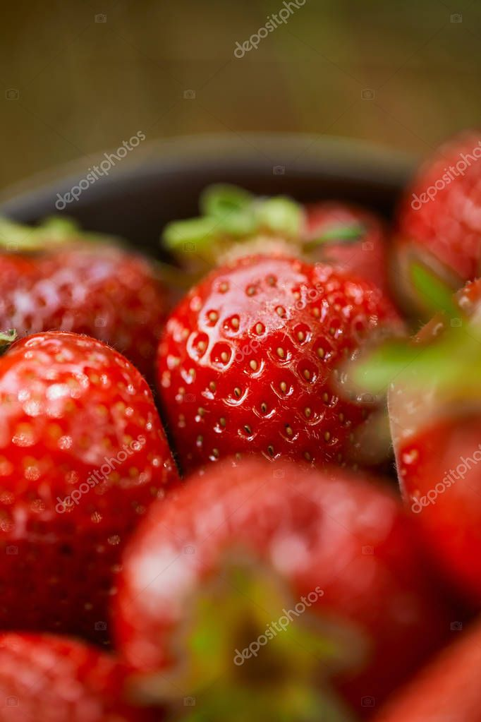 selective focus of raw sweet strawberries in bowl